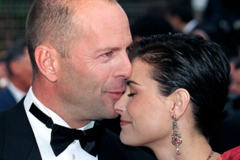 "U.S. actor Bruce Willis and his wife U.S. actress Demi Moore arrive for the screening of ""le Cinqui.."