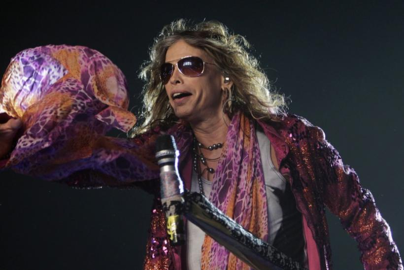 Steven Tyler, the lead singer of rock band Aerosmith, performs during a concert on the first stop of their Latin America tour at the Jockey Club in Asuncion