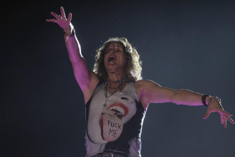 Steven Tyler of Aerosmith makes a face while performing at a concert on the first stop of their Latin America tour at the Jockey Club in Asuncion