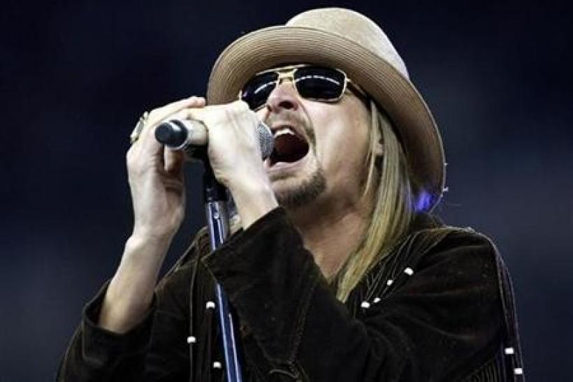 Singer and songwriter Kid Rock performs his new song and album title track ''Born Free'' during halftime of the Thanksgiving Day NFL football game between the Detroit Lions and the New England Patriots in Detroit, Michigan