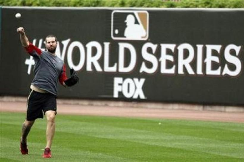 St. Louis Cardinals pitcher Chris Carpenter has a light workout in the rain at Busch Stadium after Major League Baseball cancelled Game 6 of the World Series in St. Louis, Missouri