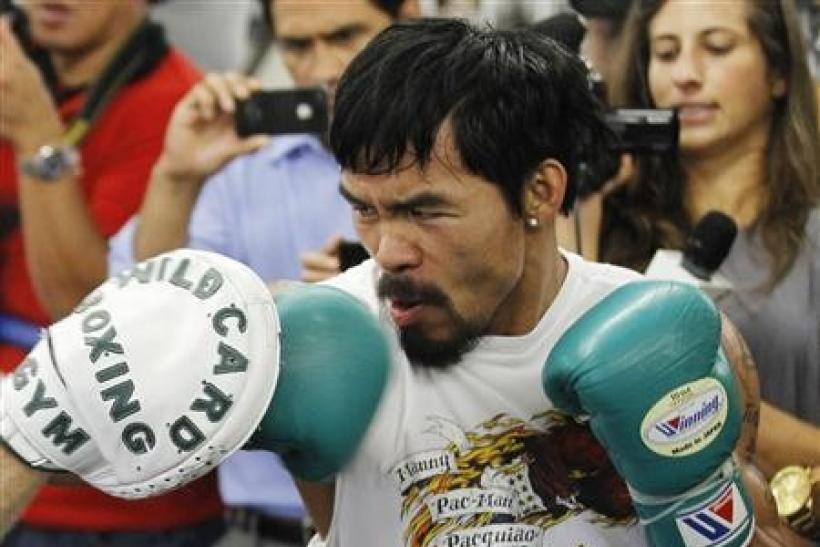 Congressman and boxer Manny Pacquiao of the Philippines trains during a media workout at Wild Card Boxing Club in Los Angeles October 26, 2011.