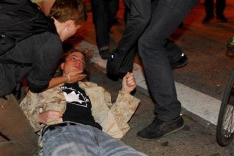 Occupy Oakland protester Scott Olsen, a former U.S. Marine and Iraq war veteran, lies on the street after being injured during a demonstration in Oakland, California