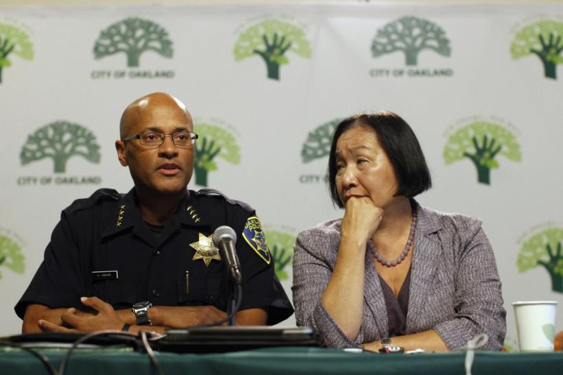 Oakland Mayor Jean Quan listens as Oakland Police Chief Howard Jordan speaks during a news conference at Oakland City Hall