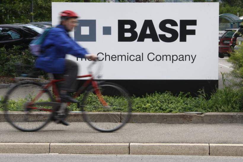 A cyclist rides his bike bast the entrance of the BASF plant in Schweizerhalle