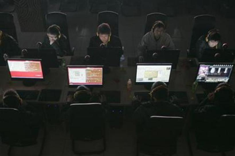 Customers use computers at an internet cafe in Taiyuan