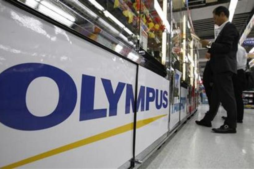 A logo of Japan's Olympus Corp is pictured at an electronic store in Tokyo