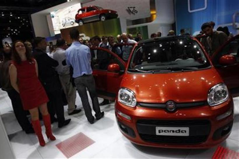 Models pose in front of a Fiat Panda during the International Motor Show (IAA) in Frankfurt