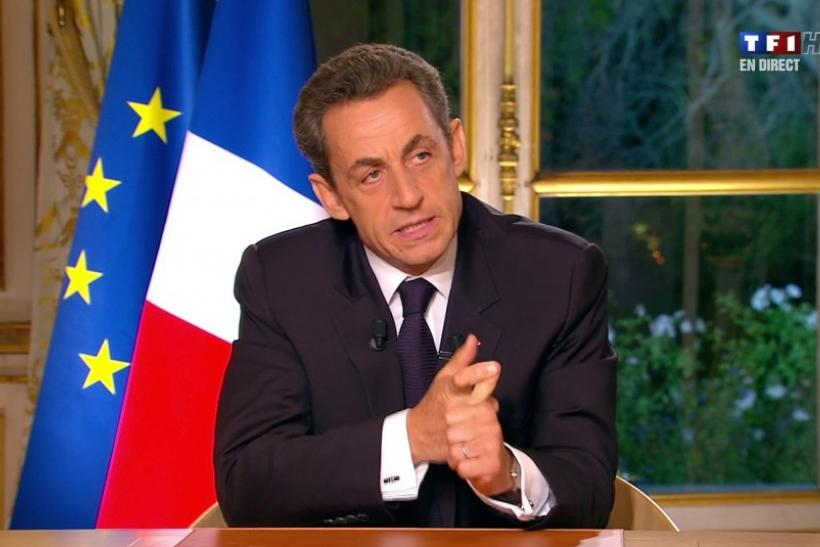 France's President Sarkozy, seen in this video grab from TF1 French television in a prime time interview from the Elysee Palace in Paris, speaks to the nation about the eurozone economy