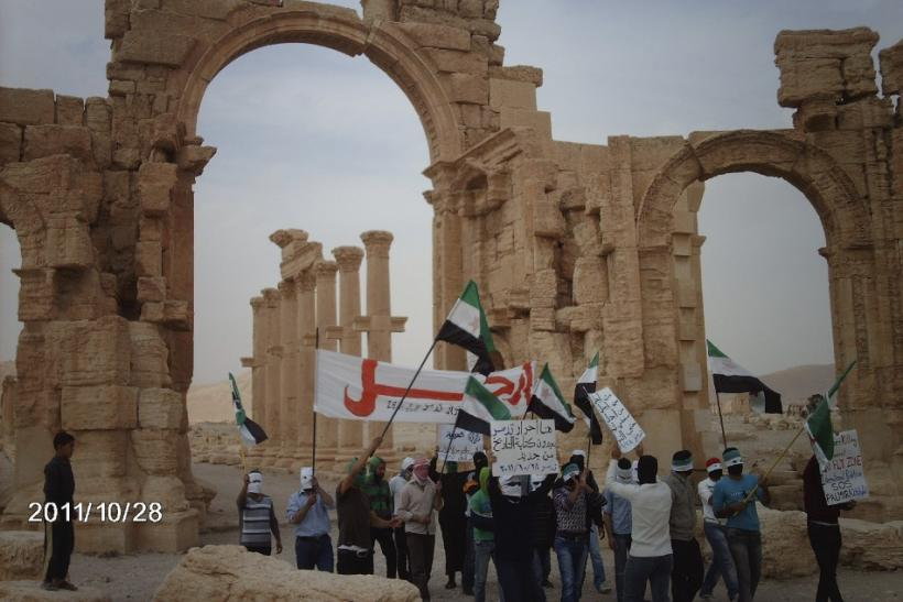 Demonstrators protest against Syria's President Bashar al-Assad in the ancient city of Palmyra