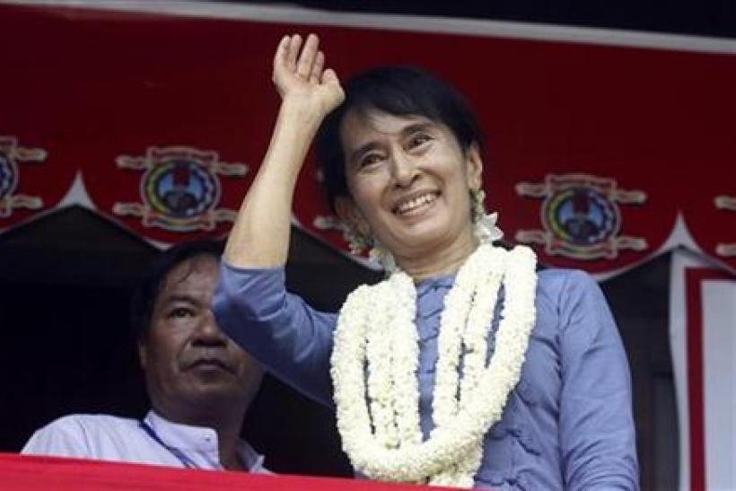 Suu Kyi, leader of Myanmar's democratic opposition, waves during the opening ceremony of Aungsan Jar-mon Library at Thanatpin township near Bago