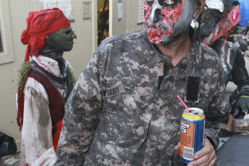 """A """"creature"""" takes a break before heading into the House of Torment haunted house in Austin, Texas"""
