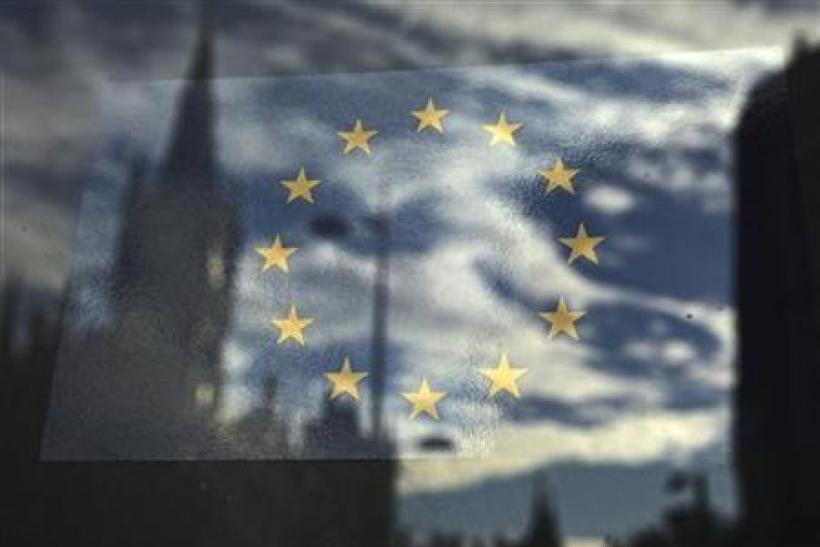 The European Union flag is pictured in a window reflecting a street in London