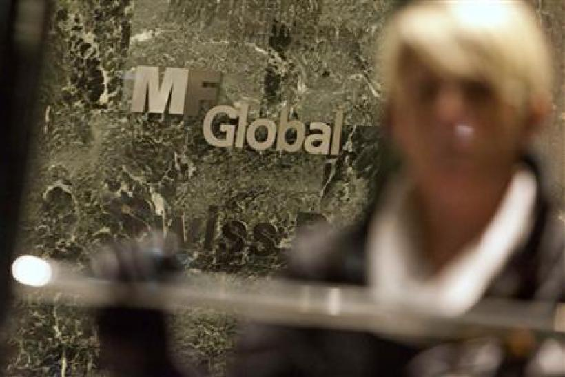 A woman leaves the office complex where MF Global Holdings Ltd has an office in midtown Manhattan