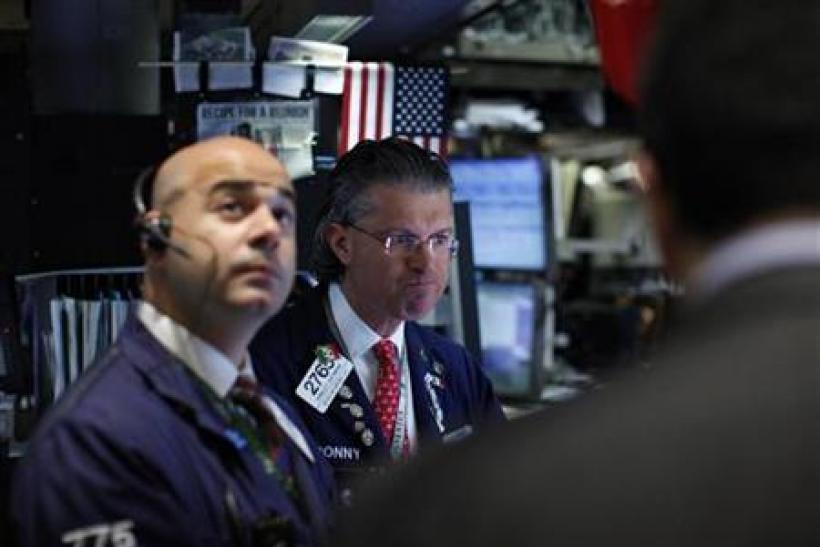 Traders work on the floor of the New York Stock Exchange October