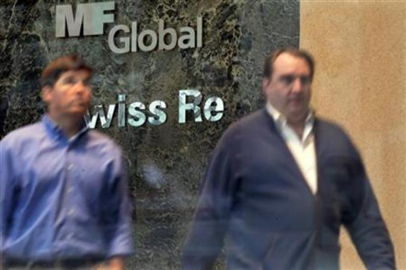 Two men exit the office complex where MF Global Holdings Ltd have an office on 52nd Street in midtown Manhattan New York