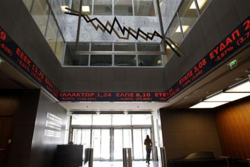 Stock prices are displayed inside the Stock Exchange in Athens