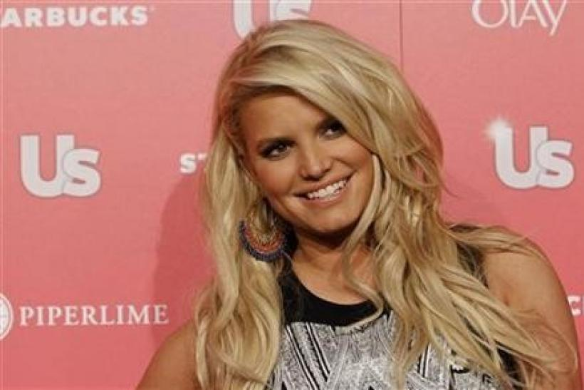 Actress and honoree Jessica Simpson poses at the US Weekly Hot Hollywood Style issue party in Hollywood