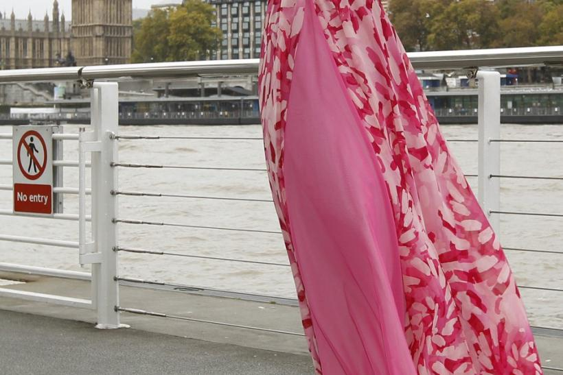 Miss World 2011 contestant, Miss Puerto Rico Amanda Perez poses for photographers in front of the Houses of Parliament and the Big Ben clocktower in London October 31, 2011.