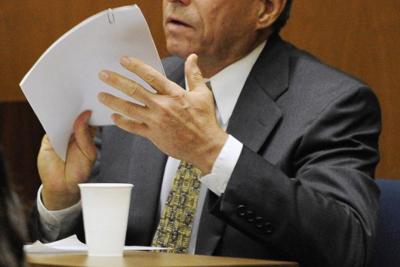 Dr. Paul White reviews a document during the final stage of Dr. Conrad Murray's defense during his involuntary manslaughter trial in the death of singer Michael Jackson at the Los Angeles Superior Court