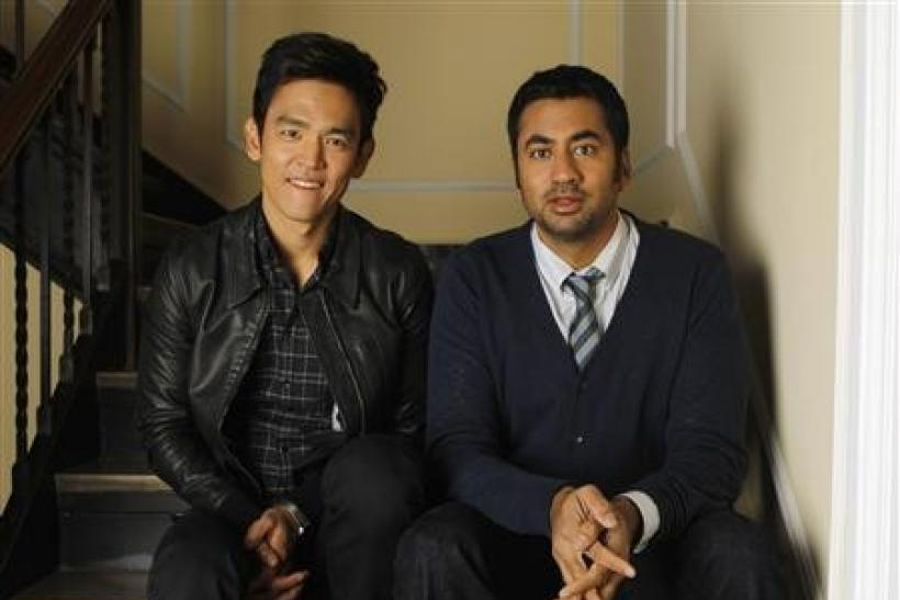 Actors John Cho (L) and Kal Penn pose for a portrait while promoting their upcoming movie ''A Very Harold & Kumar 3D Christmas'' in Beverly Hills, California