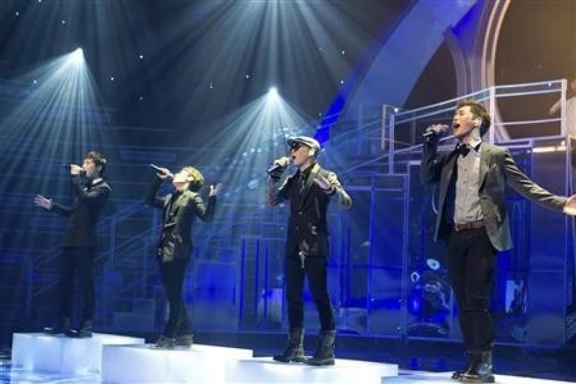 Leader of the group Ulala Session, Lim Yoon-taek (2nd R), performs with team mates during a cable television competition programme Superstar K in Seoul