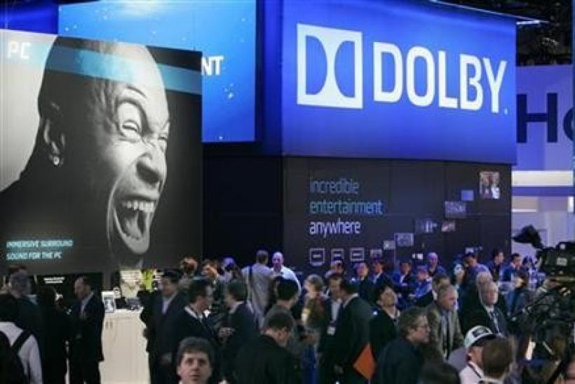 Show-goers pass by the Dolby booth during the 2010 International Consumer Electronics Show (CES) in Las Vegas, Nevada