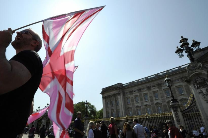 A demonstrator carries a pink Union flag outside Buckingham Palace during a protest against Britain's gay marriage ban, in London