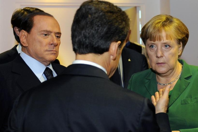 France's President Sarkozy speaks with Germany's Chancellor Merkel and Italy's Prime Minister Berlusconi during a Eurozone meeting before the start of the G20 Summit of major world economies in Cannes