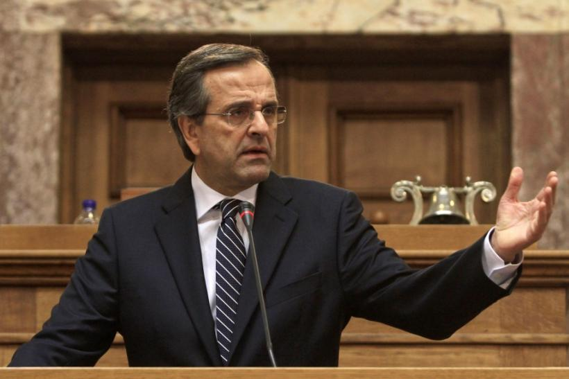 Leader of Greek conservative New Democracy party Antonis Samaras delivers a speech to his parliamentarians inside the parliament in Athens