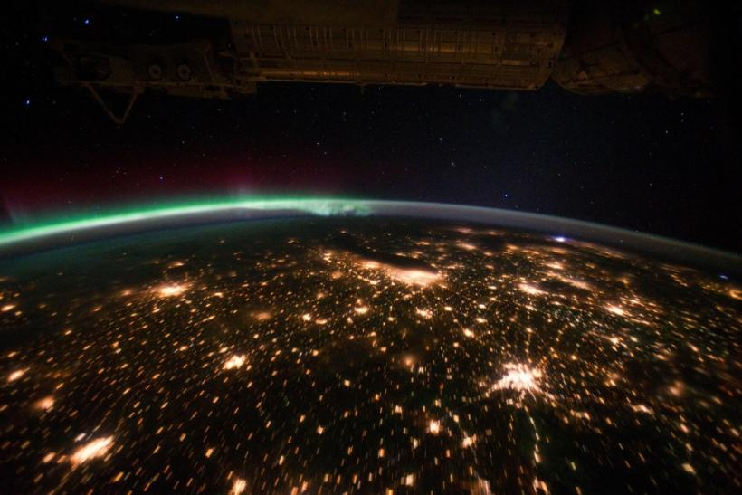 NASA handout photo shows a view of the Midwestern United States at night with Aurora Borealis, taken from the International Space Station