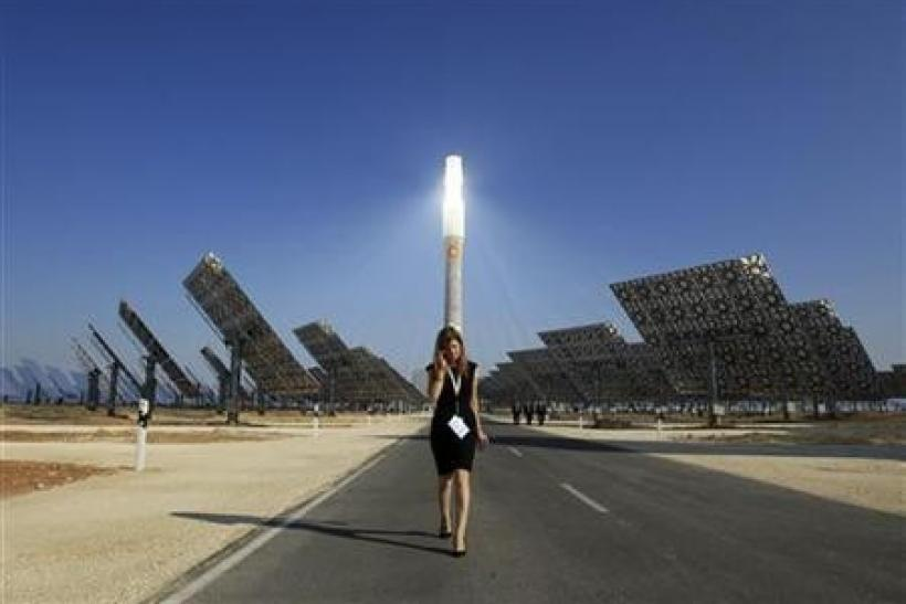 A woman walks at the new solar power plant ''Gemasolar'' the day of its inauguration in Fuentes de Andalucia, southern Spain