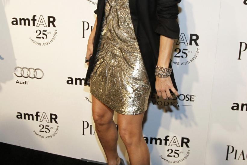 Actress Sandra Bullock smiles as she arrives at the amfAR's Inspiration LA Gala in Hollywood