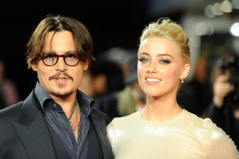 Johnny Depp and Amber Heard pose for photographers as they arrive for the European premiere of 'The Rum Diary', London
