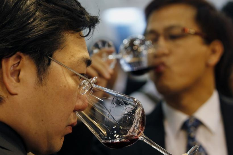 Visitors examine wine Vinexpo Asia-Pacific held at the Hong Kong Convention and Exhibition Centre