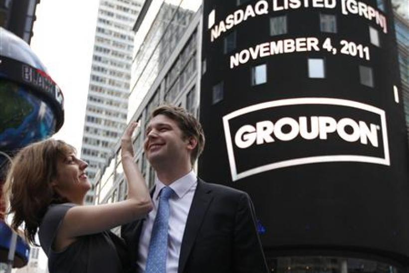 Groupon CEO Mason poses with his fiancee, pop musician Gillespie, outside Nasdaq Market in New York