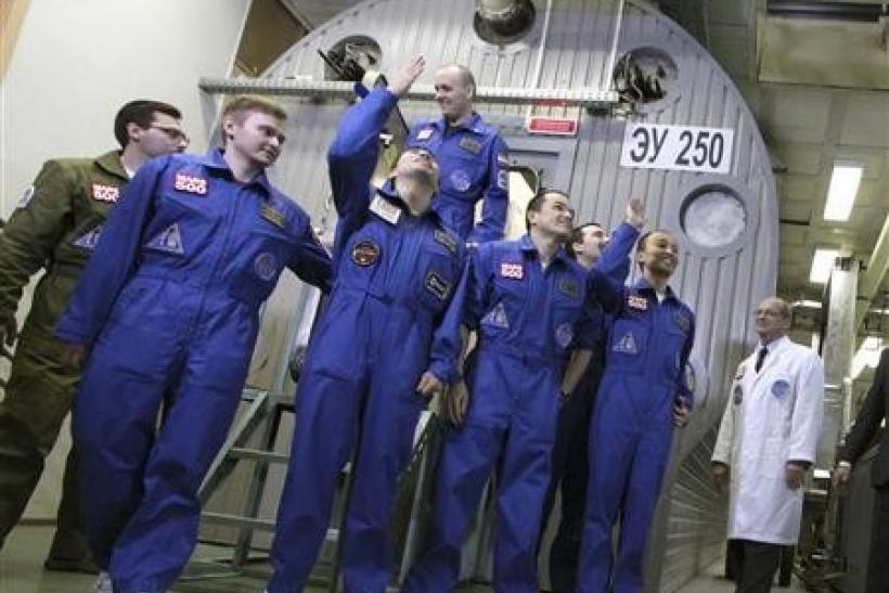 Mars500 experiment crew members react after leaving the mock spaceship in Moscow