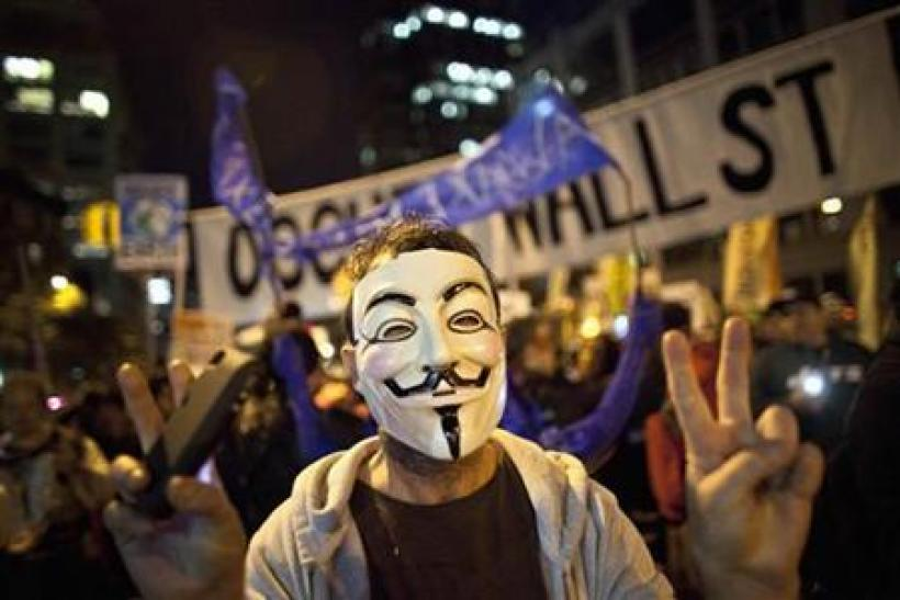 An Occupy Wall Street protestor wearing a Guy Fawkes mask takes part in the 39th Annual Halloween Parade in New York