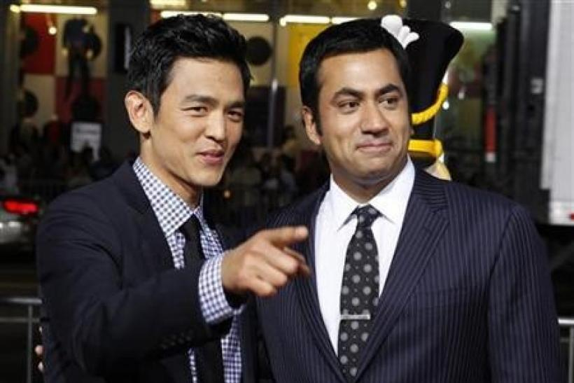 Actors John Cho (L) and Kal Penn pose at the premiere of their new film ''A Very Harold & Kumar 3D Christmas'' in Hollywood