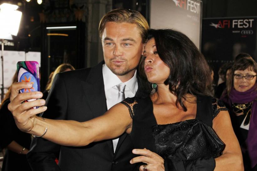 "Actor Leonardo DiCaprio poses for a photo with director Clint Eastwood's wife Dina at the opening night gala for AFI Fest 2011 with the premiere of his new film film ""J. Edgar"" directed by Eastwood in Hollywood"
