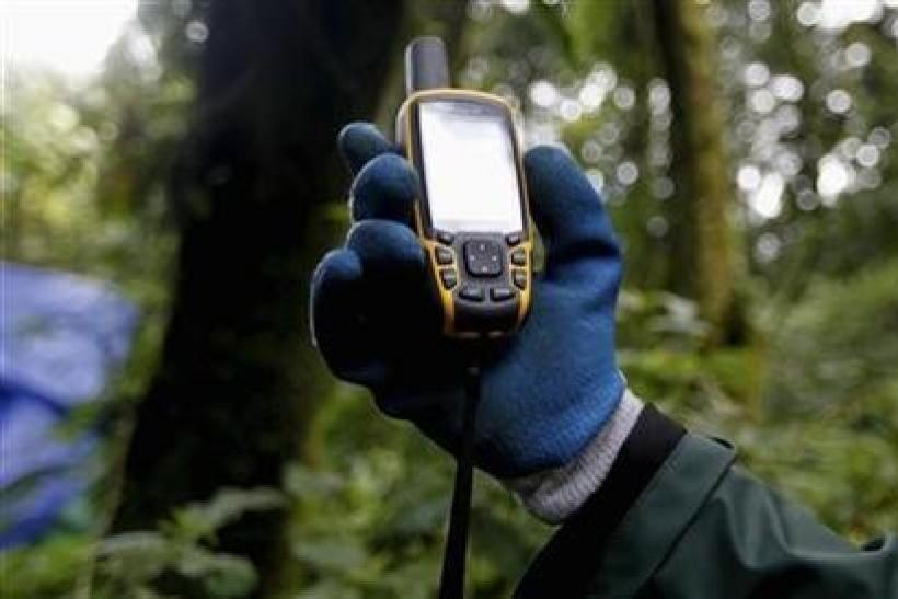 A scientist holds up a GPS device inside Bwindi Impenetrable National Park, Uganda, October 14, 2011.