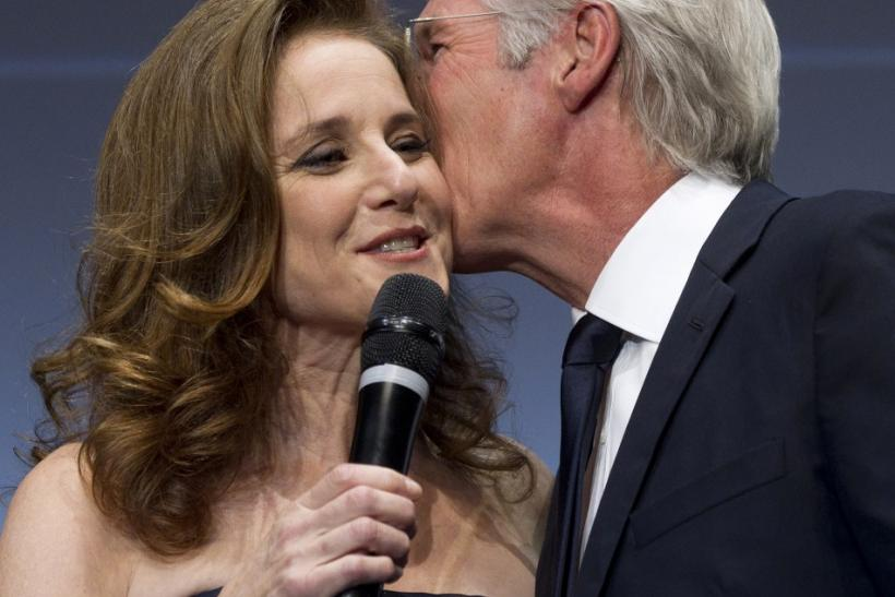 U.S. actor Richard Gere (R) kisses U.S. actress Debra Winger during the Marcus Aurelius award ceremony at the Rome Film Festival