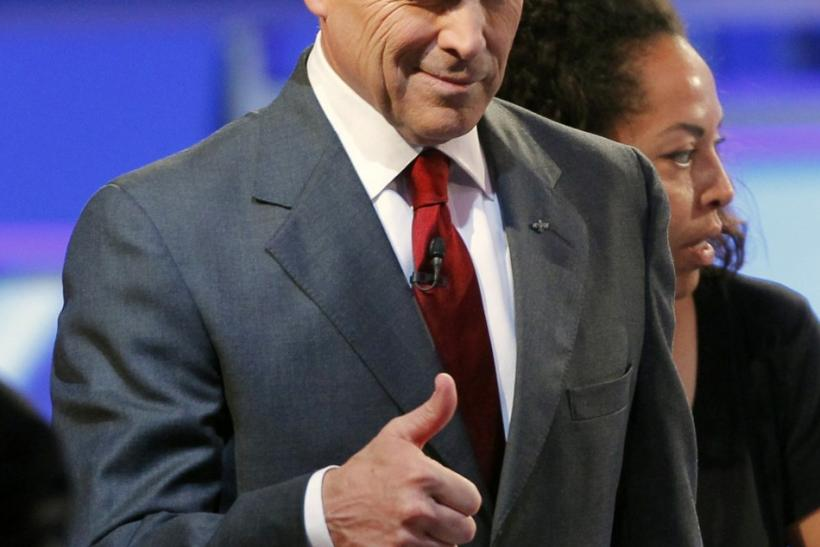 Texas Governor Rick Perry gives a thumbs up and winks during the CNN/Tea Party Republican presidential candidates debate in Tampa, Florida September 12, 2011.