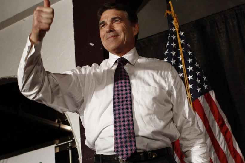U.S. Republican presidential candidate Texas Governor Rick Perry gives a thumbs-up to the crowd at the Republicans of Black Hawk County Dinner in Waterloo, Iowa, August 14, 2011.
