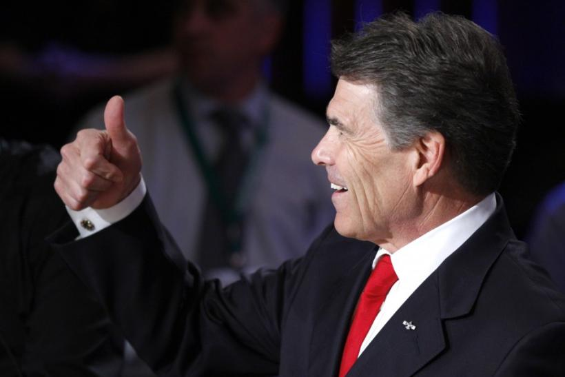 Republican presidential hopefuls Texas Gov. Rick Perry gives a thumbs up at the Republican presidential debate at Dartmouth College in Hanover, New Hampshire October 11, 2011.