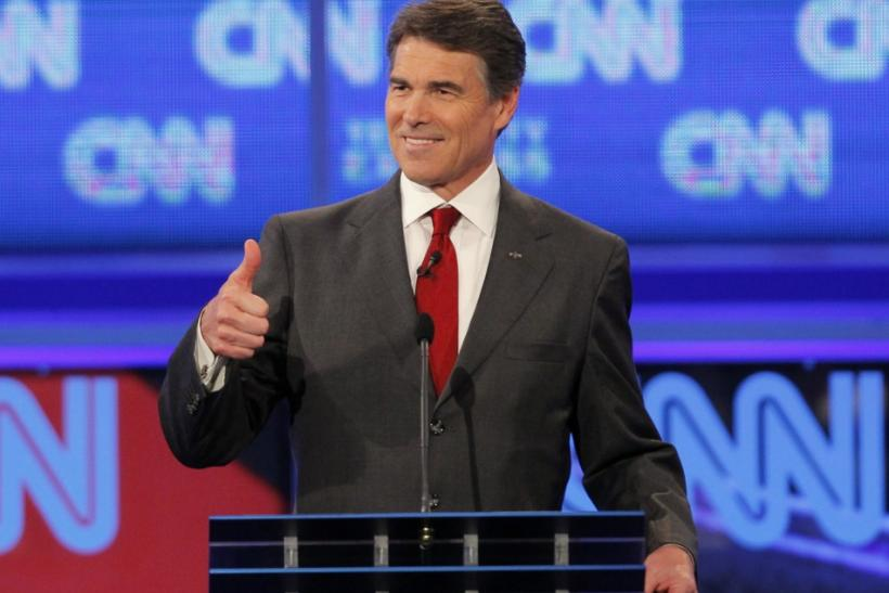 Texas Governor Rick Perry gives a thumbs up during the CNN/Tea Party Republican presidential candidates debate in Tampa, Florida September 12, 2011.