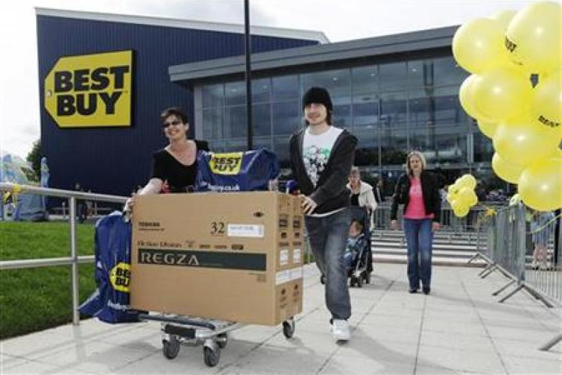 Shoppers push a television from Britain's first Best Buy store, which the U.S. retailer opened early Friday, in Thurrock