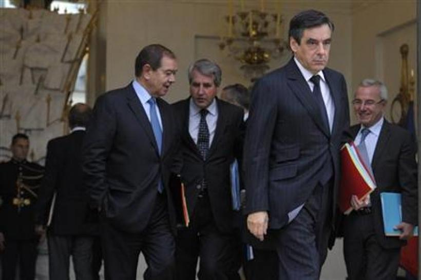 France's Prime Minister Francois Fillon leaves the Elysee Palace following the weekly cabinet meeting
