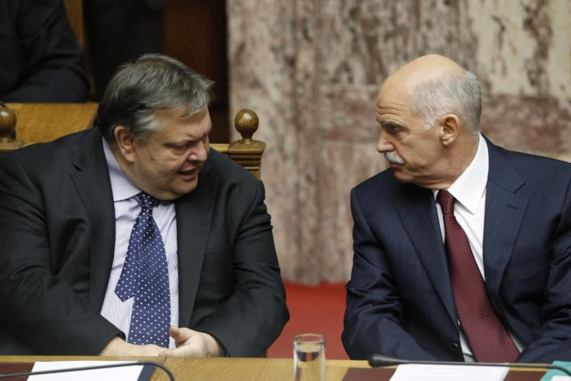 Greek Finance Minister Evangelos Venizelos (L) and Prime Minister George Papandreou talk in the parliament prior to a confidence vote in Athens November 4, 2011.