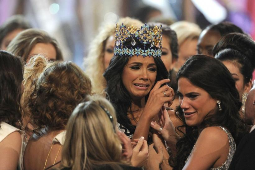 Miss Venezuela, Ivian Sarcos, is congratulated by other contestants after being crowned Miss World 2011 in Earls Court in west London